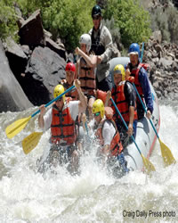 A group of boys whitewater rafting